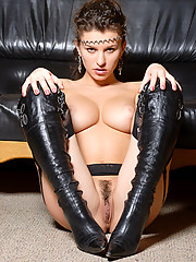 Tall boots on this dominatrix who has natural breasts and big nipples you will want to clamp as she whips your ass.